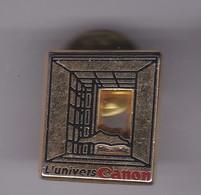 Pin's UNIVERS CANON SIGNE ARTHUS BERTRAND - Trademarks