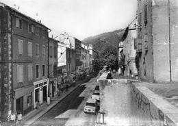 CPSM Dentelée - SAINT-PONS (34) - Aspect De La Rue Principale Et De L'auto Ecole Dans Les Années 50 / 60 - Saint-Pons-de-Mauchiens