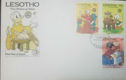 L) 1985 LESHOTO, DISNEY, PATO DONALD, SEWING, THE WISING TABLE, THE BROTHERS GRIMM BICENTENARY, FDC - Lesotho (1966-...)