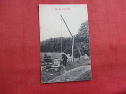 Man At The Well-  Ref 2867 - Postcards