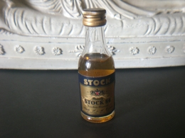 STOCK 84 BOTTIGLIA MIGNON BRANDY VINTAGE SIGILLATA - Miniatures