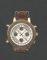 PINS PIN'S MONTRE HORLOGE CHRONO SEIKO  RELIEF 30 MMS ARTHUS BERTRAND - Pin's