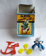 FIGURINE SCHTROUMPF - SMURF - PIFUTOS  - Boîte SUPER SCHTROUMPF TRICYCLE 1978 1 NON MONTE - Smurfs