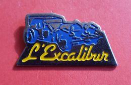 "Pin's : ""L'EXCALIBUR ""  Garage   Joli - Andere"