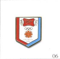 Pin's J.O De Sarajevo De 1984 - Sponsor Bière Miller. Est. XIVè J.O Hiver Sarajevo' 84 ©️1982 Ocog. Métal Peint. T584-06 - Beer