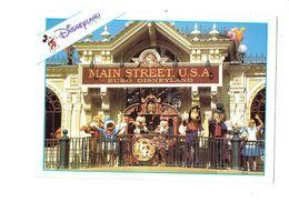 Cpm - Disney > Disneyland Paris - Main Street Station U.S.A. Euro - MICKEY DONALD DINGO MINNIE Lapin Alice Renard - Disneyland