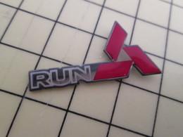 PIN916c Pin's Pins / Rare Et Beau : AUTOMOBILES / LOGO MITSUBISHI RUN - Mitsubishi