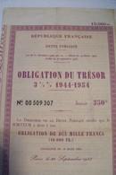 OBLIGATION  DU  TRESOR   - OBLIGATION DE DIX MILLE FRANCS  - 1944 - 1954  - 3 1/2  % - Shareholdings