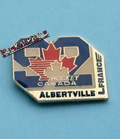 Pin's Jeux Olympiques D' Albertville 1992, équipe De Hockey Sur Glace Du CANADA, Feuille D'érable, Ice Hockey - Jeux Olympiques