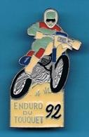 1 PIN'S //  ** ENDURO DU TOUQUET / 92 ** . (Vainqueur: Yann Guedard Kawasaki) - Motorbikes
