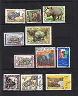 DT176F ANIMAUX AFRIQUE LOT 11 TIMBRES MONDE MAMMIFERES ELEPHANT RHINOCEROS HIPPOPOTAME - Eléphants