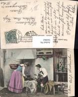 563062,Paar In Tracht Am Herd Herdstelle Kochen Ofen Heizung Spinnrad - Ansichtskarten