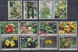 Comores Taxe N° 6 / 17 O Fleurs Les 12 Valeurs Oblityérations Légères Sinon TB - Comores (1975-...)