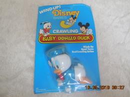 WIND'UP DISNEY BABIES BABY DONALD DUCK CRAWLING MADE IN HONG KONG..VINTAGE 1984..NEUF - Disney