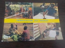 CPSM  AFRIQUE COTE D IVOIRE FABRICATION DES PAGNES   VOYAGEE  NON  TIMBREE - Ivory Coast