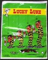 SAC LUCKY LUKE EN PLASTIQUE PUBLICITAIRE MORRIS 34X 43cm SACCUPLASTIKOPHILE COLLECTIONNEUR PUBLICITÉ - SITE Serbon63 - Publicité