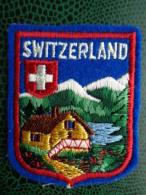 ECUSSON TISSU  BRODE DE SWITZERLAND - Blazoenen (textiel)