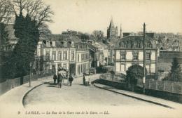 61 L'AIGLE / La Rue De La Gare Vue De La Gare / - L'Aigle