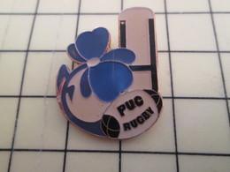815b : Pin's Pins / RARE & BELLE QUALITE / THEME : SPORTS / RUGBY CLUB PUC BALLON OVALE FLEUR BLEUE - Rugby