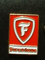 PIN'S PNEU FIRESTONE - LOGO FOND ROUGE - Badges