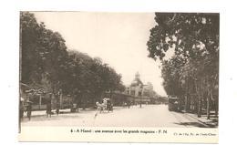 CPA Indochine A Hanoï Une Avenue Avec Les Grands Magasins - Cartes Postales