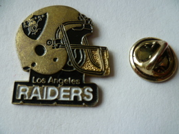 PIN'S  FOOTBALL  AMERICAIN   CASQUE LOS ANGELES  RAIDERS - Badges