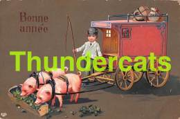 CPA EN RELIEF GAUFREE GARCON ATTELAGE  COCHON EMBOSSED CARD BOY CARRIAGE  PIG EAS - Cochons