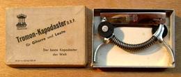 CLE A GUITARE MARCA TROMON- KAPODASTER D.R.P. FUR GITARRE UND LAUTE DER BESTE KAPODASTER DER WELT - Musica & Strumenti