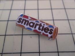 410c Pin's Pins / Beau Et Rare : Thème ALIMENTATION / SMARTIES CHOCOLAT BONBONS - Food