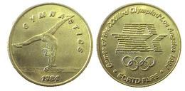 03876 GETTONE JETON TOKEN TRASPORTO TRANSIT GAMES OF THE XXIIIrd OLYMPIAD LOS ANGELES 1984 SCRTD FARE GYMNASTICS - USA