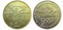 03885 GETTONE JETON TOKEN TRASPORTO TRANSIT GAMES OF THE XXIIIrd OLYMPIAD LOS ANGELES 1984 SCRTD WEIGHT LIFTING - USA