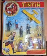 Boite D' Origine, état Neuf Contenant 9 Personnages Et Un Avion Des Aventures De TINTIN ( Le Secret De La Licorne) - Tintin
