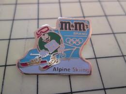 2317 Pin's Pins / Rare Et Beau THEME ALIMENTATION / CHOCOLATS M&M'S JEUX OLYMPIQUES ALPINE SKIING - Food