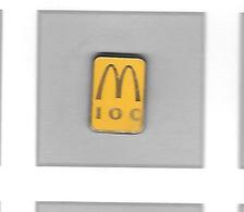 Pin's  Jaune  MAC  DO  I O C    Signé  ARTHUS  BERTRAND -  PARIS - McDonald's