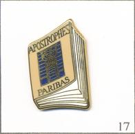 """Pin's Télévision / Emission """"Apostrophes"""" (B. Pivot Antenne 2) - Sponsor Paribas-Couverture Rose Pâle. Est. A.B. T607-17 - Médias"""