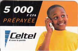 BURKINA FASO - Boy On Phone, Celtel Prepaid Card 5000 F CFA, Exp.date 31/07/04, Used - Burkina Faso