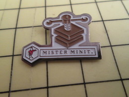 Sp08 Pin's Pins / Beau Et Rare / THEME : MARQUES / MISTER MINIT IMPRIMERIE ? - Trademarks
