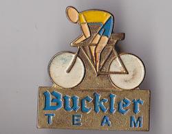 PIN'S THEME CYCLISME  TEAM  BUCKLER - Cycling