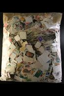 BRITISH COMMONWEALTH An All Periods Off Paper Mostly Used Assortment In A Large Packet (weight 1kg), Looks Like Much Goo - Stamps