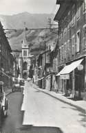 """/ CPSM FRANCE 73 """"Albertville, Rue Gambetta Et L'église"""" - Albertville"""