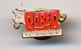 "{10032} Pin's "" Rober, Le Boucher ""   "" En Baisse "" - Levensmiddelen"
