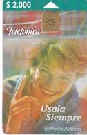 TARJETA DE CHILE DE TELEFÓNICA DE $2000 CON UNA MUJER (WOMAN) - Chile