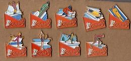Lot De 9 Pin's Yoplait - Jeux Olympiques Albertville 1992 (sports Hiver) - Olympic Games