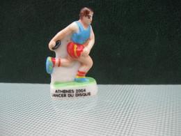 Fève Lancer Du Disque Série Personnalisée Baguépi Athènes 2004  * Fèves - Rare T Perso - Sports