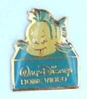 "Pin's Walt Disney HOME VIDEO - POLOCHON - Le Poisson De ""La Petite Siréne"" - Disney - H171 - Disney"