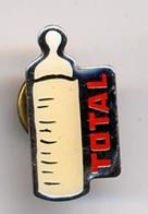 "{07126} Pin's "" TOTAL , Biberon "".            "" En Baisse "" - Fuels"