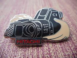 A006 -- Pin's Fraisse -- Camescope Hitachi - Trademarks