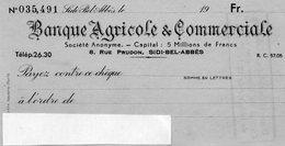 ALGERIE  ..banque Agricole De Commerce....SIDI-BEL -ABBES..l Ecriture Du Cheque Est Bleue  Pb De Scan... - Chèques & Chèques De Voyage