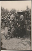 An Elderly Couple In The Garden, 1931 - RP Postcard - Photographs