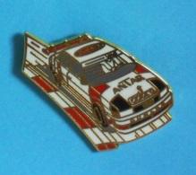1 PIN'S  //   ** AUDI / DTM / ANTAR / COBRA / DUNLOP ** . (Arcane Paris Patent) - Audi